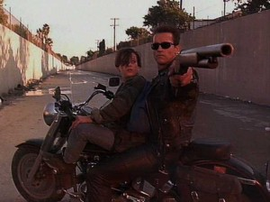 [Terminator protecting the young John Connor.]