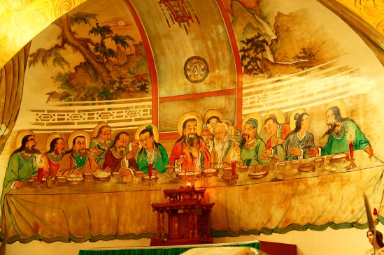 [The fresco here, right above and behind a very Chinese tabernacle, illustrates the Last Supper.]