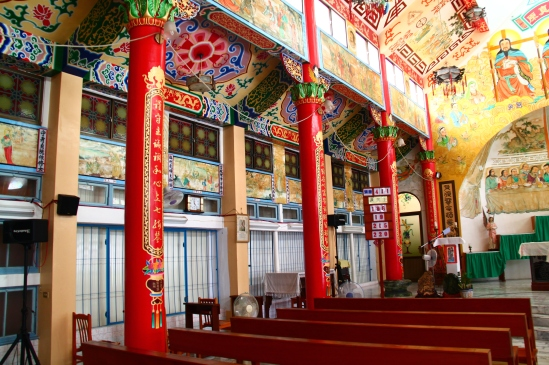 [Red columns support the ceiling here, probably columns of wood since Traditional Chinese architecture for sacred spaces tended toward precious woods (like teak) rather than precious stones.]