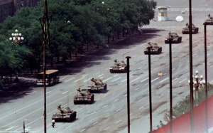 [Do you see him? The lone man against the column of tanks?]